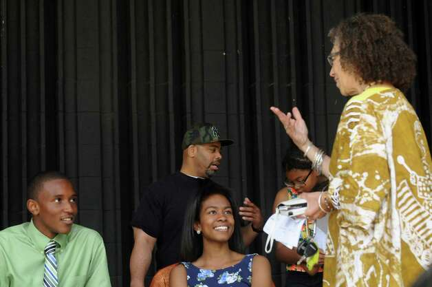 Co-chair of the Juneteenth celebration Miki Conn, right, talks with teen King and Queen of Juneteenth Troy Dickson, left, and Brieanna Girdhari, center, during the Hamilton Hill Arts Center 15th annual celebration of Juneteenth at Central Park on Saturday June 20, 2015 in Schenectady, N.Y.  (Michael P. Farrell/Times Union) Photo: Michael P. Farrell / 00032311A