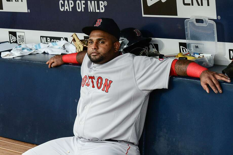 Red Sox third baseman Pablo Sandoval sits after being benched for Thursday's game because he liked an Instagram picture during Wednesday's contest — a violation of the team's social media and phone policy. Photo: Jon Barash, Associated Press