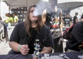 Vincent Tantaero, of Modesto samples the products from, Flyhigh Extracts, one of the many vendors gathered for Cannabis Cup, the world's largest marijuana trade show taking place at the Cow Palace in San Francisco, Calif. on Sat. June 20, 2015.
