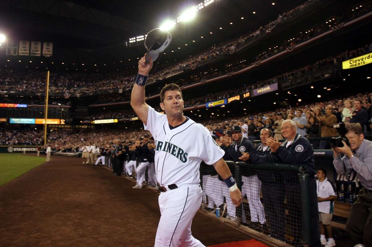 SEATTLE - OCTOBER 2: Edgar Martinez #11 of the Seattle Mariners waves to fans as he takes the field during a post game ceremony honoring his career as a Mariner after the game against the Seattle Mariners on October 2, 2004 at Safeco Field in Seattle, Washington. (Photo by Otto Greule Jr/Getty Images)