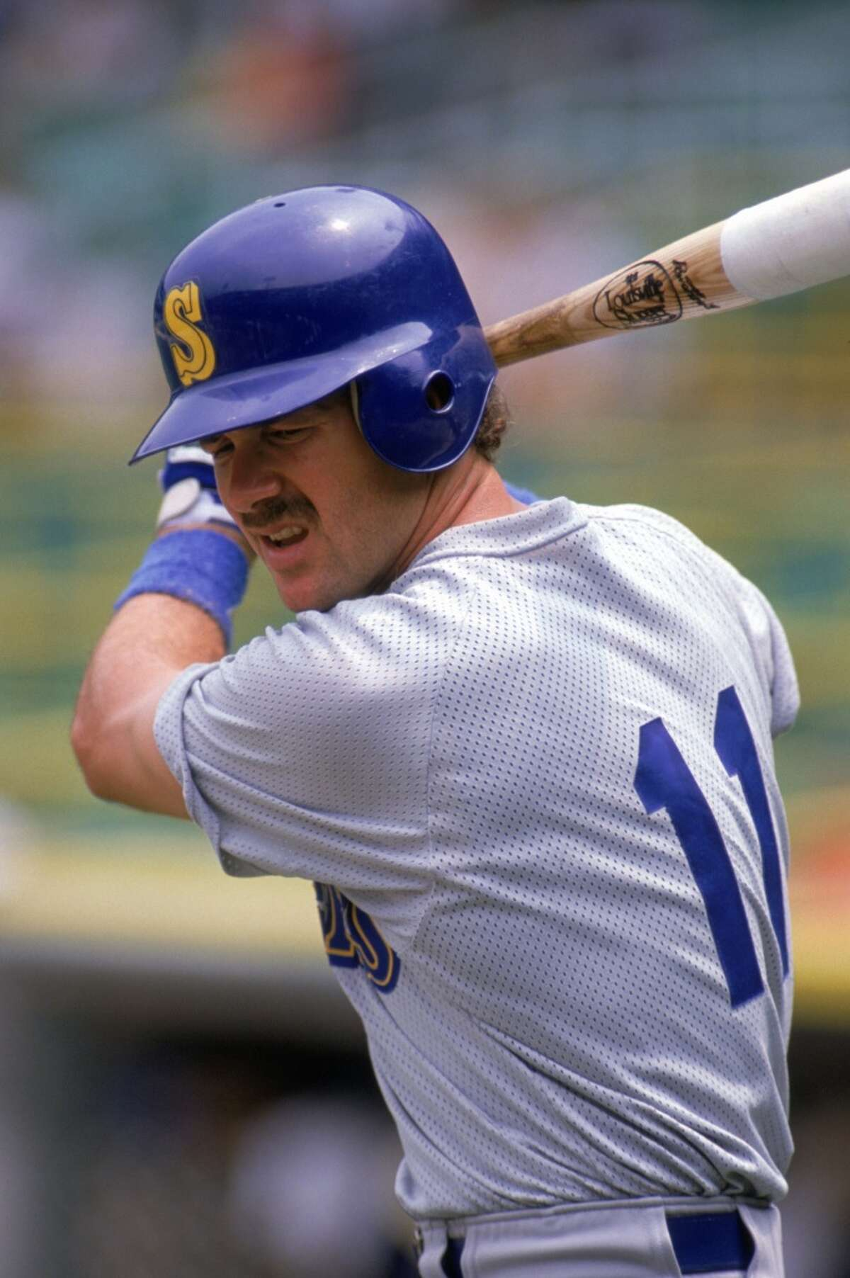 1989: Edgar Martinez of the Seattle Mariners practices his swing during a game against the Chicago White Sox at Comiskey Park in August 1989 in Chicago, Illinois.