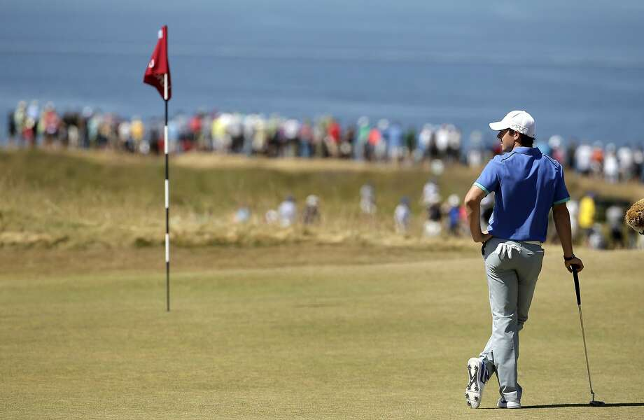Northern Ireland's Rory McIlroy, ranked No. 1 in the world since August, stands on the fifth green of his even-par third round Saturday at Chambers Bay. Photo: Charlie Riedel, Associated Press