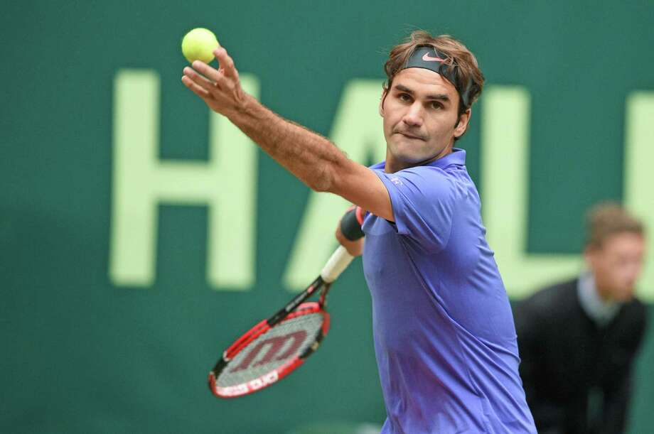 HALLE, GERMANY - JUNE 20:  Roger Federer of Switzerland serves in his match against Ivo Karlovic of Croatia during day six of the Gerry Weber Open at Gerry Weber Stadium on June 20, 2015 in Halle, Germany.  (Photo by Thomas Starke/Bongarts/Getty Images) ORG XMIT: 559122887 Photo: Thomas Starke / 2015 Getty Images