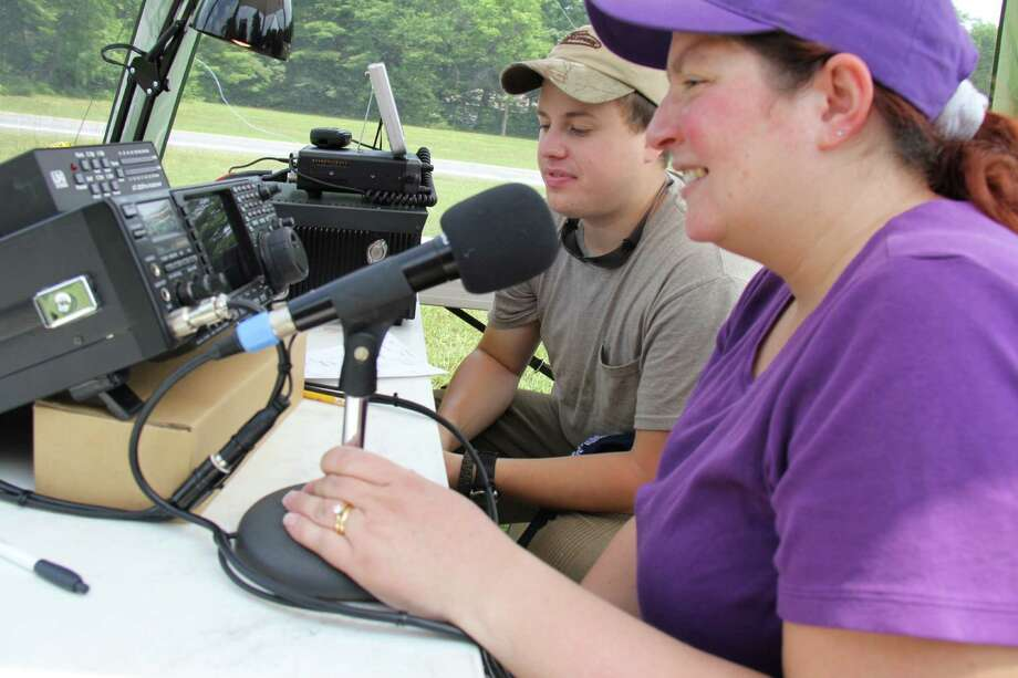 Merrideth Corentto (N2MOM) and Derrick Helms (KD2ALW) attend last year's amateur radio field day event in Lake George. (Photo provided by Donald James) Photo: Michael_Corentto