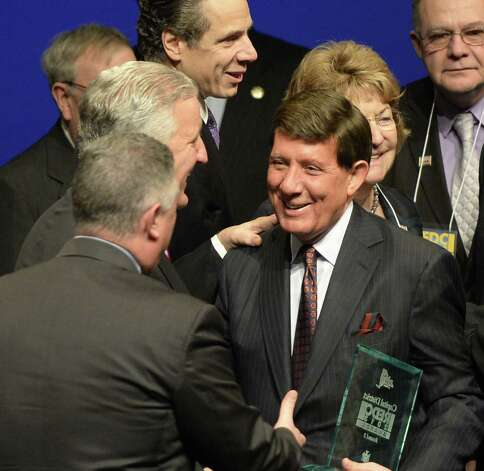 James Barba, president and CEO of Albany Med holds the award plaque and is congratulated by Albany Mayor Jerrings, second from left, and Assemblyman John McDonald, left, during the Regional Economic Development Awards presentation Wednesday morning, Dec. 11, 2013, in Albany, N.Y.  (Skip Dickstein / Times Union archive) Photo: Skip Dickstein / 00024993A