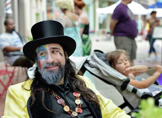"""Street performer Kristoph DiMaria of Troy dressed as Siclian folk clown """"Ragliacci"""" during the annual Troy River Fest Saturday June 20, 2015 in Troy, NY.  (John Carl D'Annibale / Times Union) Photo: John Carl D'Annibale / 00032104A"""