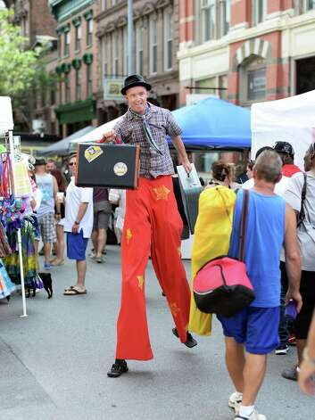 Street performer Seano Fagen of Troy makes his way through crowds on 1st Street during the annual Troy River Fest Saturday June 20, 2015 in Troy, NY.  (John Carl D'Annibale / Times Union) Photo: John Carl D'Annibale / 00032104A