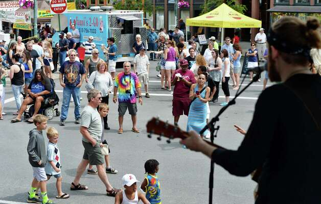 Festival goers crowd River Street as local band Hard Soul performs during the annual Troy River Fest Saturday June 20, 2015 in Troy, NY.  (John Carl D'Annibale / Times Union) Photo: John Carl D'Annibale / 00032104A