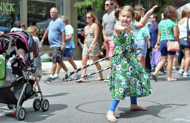 Six-year-old Layla Oathout of Watervliet tries out a Luna Hoop at the annual Troy River Fest Saturday June 20, 2015 in Troy, NY.  (John Carl D'Annibale / Times Union) Photo: John Carl D'Annibale / 00032104A