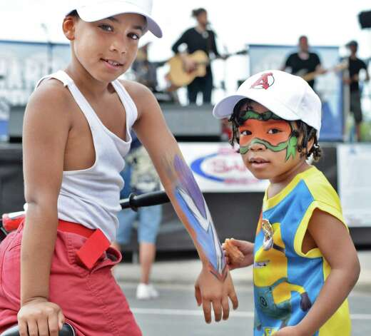 Julian Martinez, left, and Cody Collins, 4, both of Troy show off some body painting as they listen to bands  during the annual Troy River Fest Saturday June 20, 2015 in Troy, NY.  (John Carl D'Annibale / Times Union) Photo: John Carl D'Annibale / 00032104A
