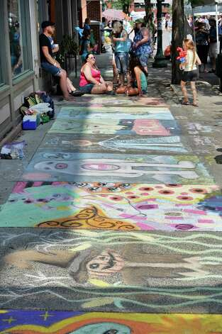 Chalk art adorns the sidewalk along River Street during the annual Troy River Fest Saturday June 20, 2015 in Troy, NY.  (John Carl D'Annibale / Times Union) Photo: John Carl D'Annibale / 00032104A