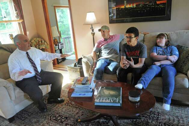 Reggie Monroe, left, and Brian Brosen at their home with two of their adopted children Misael Monroe-Brosen and Alexis Monroe-Brosen, right, on Tuesday June 16, 2015 in Colonie, N.Y.  (Michael P. Farrell/Times Union) Photo: Michael P. Farrell / 00032303A