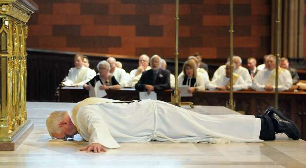 Rick Lesser lies prostrate before the altar as a sign of his humble submission to God's will as he's moved from deacon to priest during his ordination on Saturday, June 20, 2015, at the Cathedral of the Immaculate Conception in Albany, N.Y. (Cindy Schultz / Times Union) Photo: Cindy Schultz / 00032345A