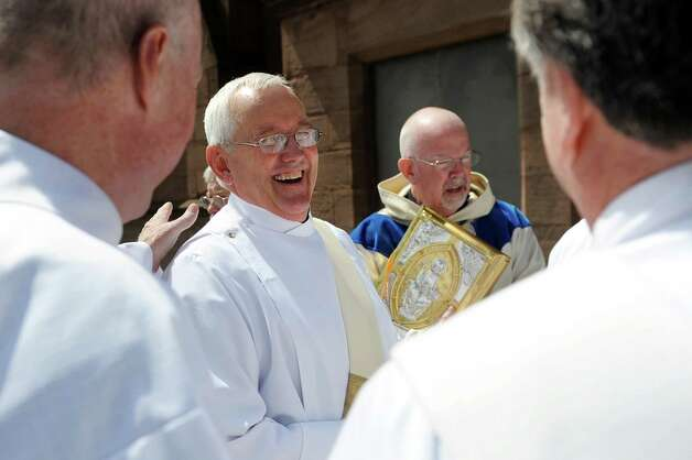 Rick Lesser, center, jokes with members of the clergy before his ordination to move from deacon to priest on Saturday, June 20, 2015, at the Cathedral of the Immaculate Conception in Albany, N.Y. (Cindy Schultz / Times Union) Photo: Cindy Schultz / 00032345A
