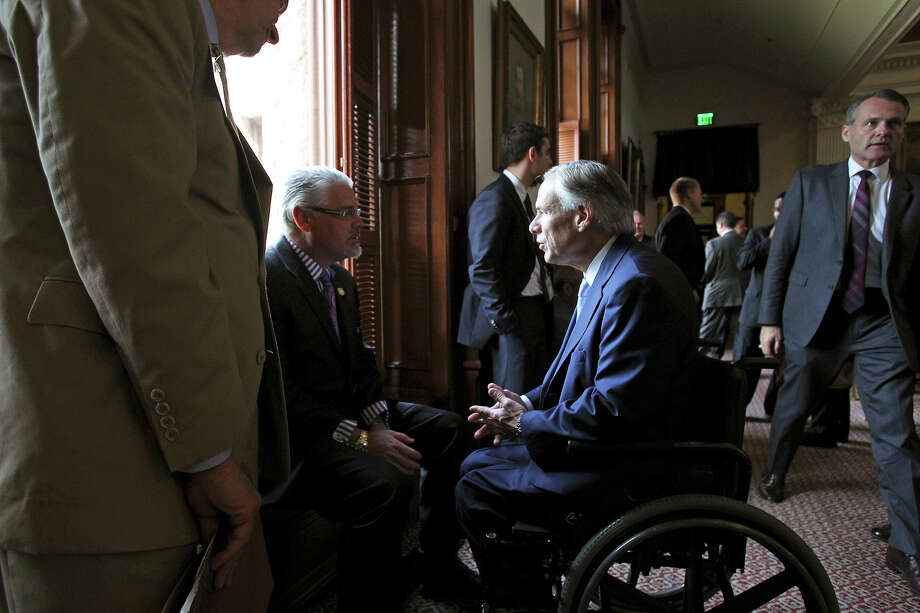 Making a stop in the hallway on the House floor, Governor Greg Abbott chats with Representative Dan Huberty (R-Houston) as he  visits the House of Representatives and the Senate while the governing bodies work on last minute legislation in Austin on May 14, 2015. Photo: Tom Reel / San Antonio Express-News