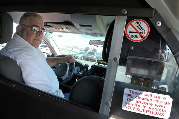 Stan Knapek is a longtime Capital Region cabdriver on Thursday June 4, 2015 in Albany , N.Y.  (Michael P. Farrell/Times Union) Photo: Michael P. Farrell / 00032153A
