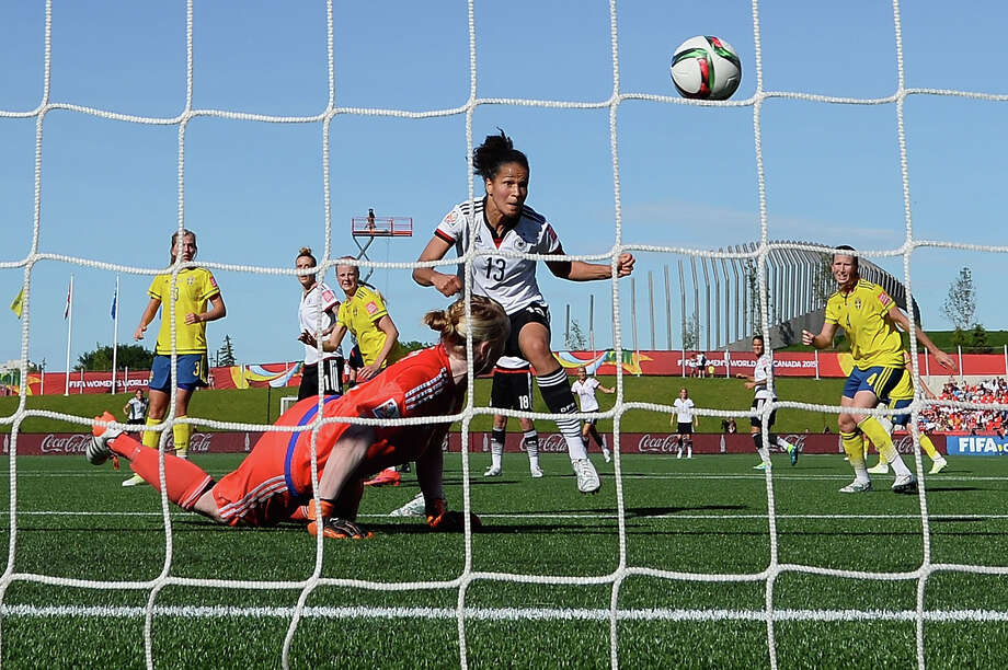 Germany's Celia Sasic beats Swedish keeper Hedvig Lindahl for one of her two goals in the 4-1 win. Photo: Dennis Grombkowski, Staff / 2015 Getty Images