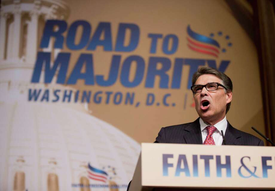 Republican presidential candidate, former Texas Gov. Rick Perry, speaks at the Road to Majority 2015 convention in Washington on Saturday. Texas Sen. Ted Cruz, another GOP candidate, also attended the faith-centric event. Photo: Manuel Balce Ceneta, STF / AP