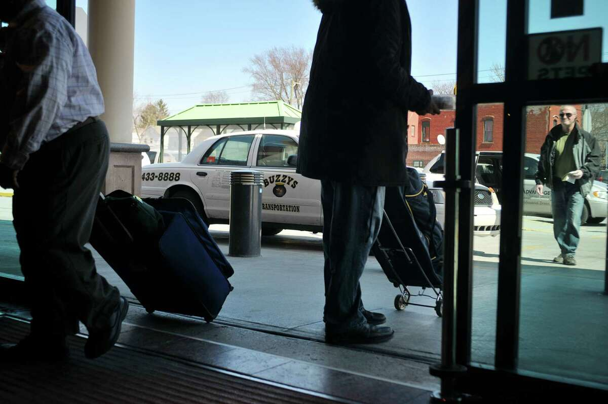 A cab driver with Buzzys Transportation drops travelers off at the Rensselaer Train Station on Thursday, April 2, 2015, in Rensselaer, N.Y. (Paul Buckowski / Times Union)