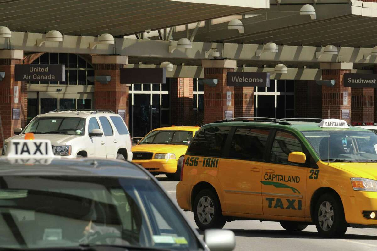 Taxis line up for pick ups at the Albany International Airport on Friday April 3, 2015 in Colonie, N.Y. (Michael P. Farrell/Times Union)