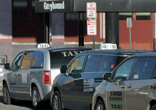 Taxis wait for passenger pick up at the Greyhound Bus terminal on Tuesday April 28, 2015 in Albany, N.Y. (Michael P. Farrell/Times Union) Photo: Michael P. Farrell / 00031637A