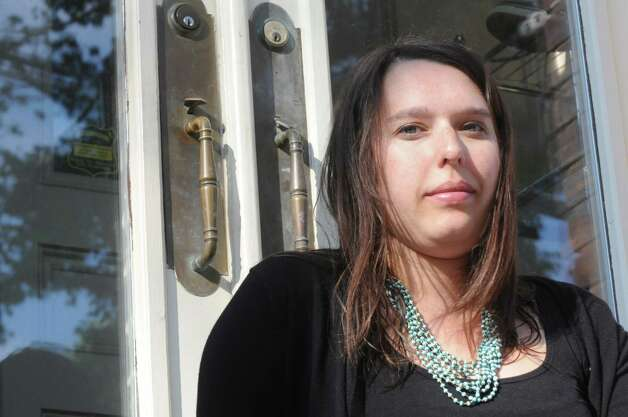 Jenna Pitera, who had a nightmarish experience when she had taking a cab in Albany, in front of her home on Thursday June 4, 2015 in Albany , N.Y.  (Michael P. Farrell/Times Union) Photo: Michael P. Farrell / 00032148A