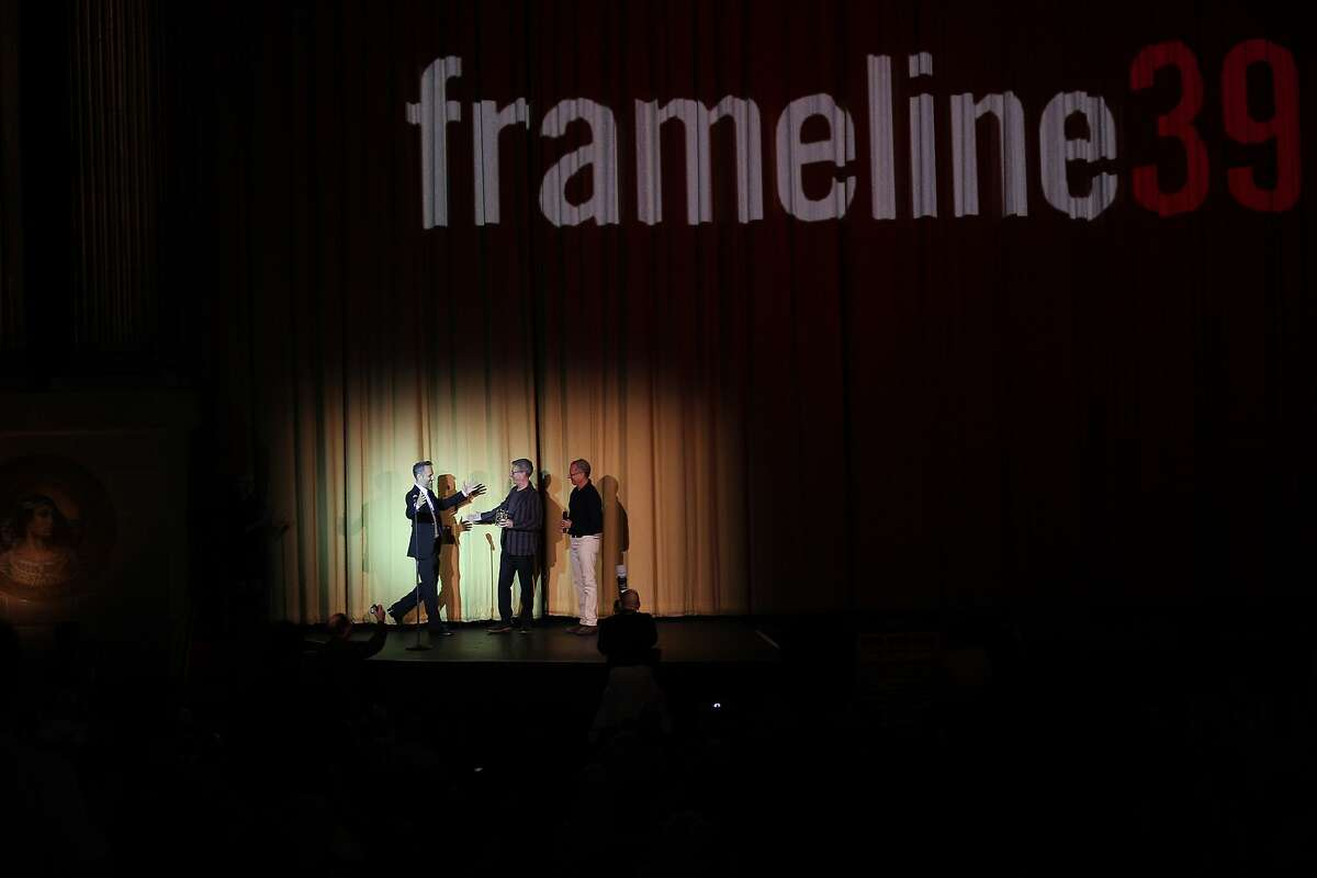 From left: Director Jeffrey Schwarz comes onstage to accept the Frameline Award from Jeffrey Friedman and Rob Epstein before a screening of the film Tab Hunter Confidential during the Frameline39 LGBTQ film festival at the Castro Theatre in San Francisco, California, on Saturday, June 20, 2015. The film is about the life and career of Tab Hunter, a formerly closeted Hollywood heartthrob of the 1950s.