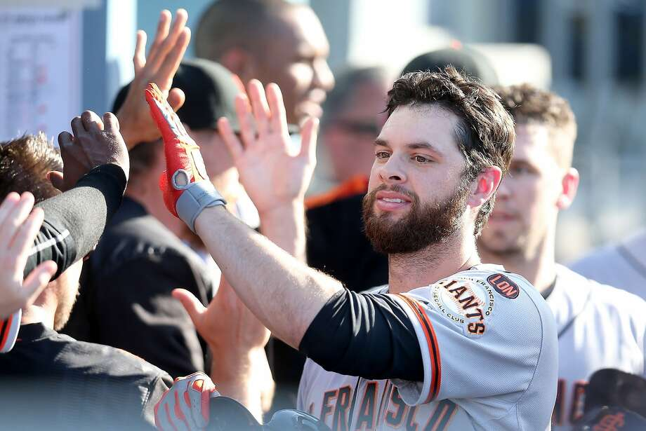 LOS ANGELES, CA - JUNE 20:  Brandon Belt #9 of the San Francisco Giants is greeted as he returns to the dugout after hitting a two run home run in the sixth inning against the Los Angeles Dodgers at Dodger Stadium on June 20, 2015 in Los Angeles, California.  (Photo by Stephen Dunn/Getty Images) Photo: Stephen Dunn, Getty Images