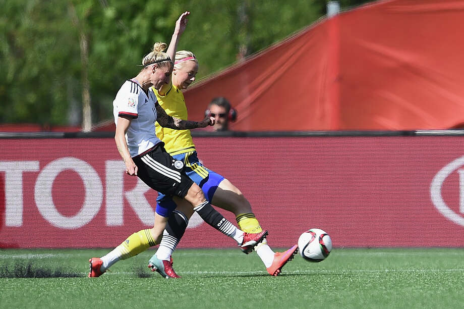 OTTAWA, ON - JUNE 20:  Anja Mittag of Germany  scores the opening goal during the FIFA Women's World Cup Canada 2015 Round of 16 match between Germany and Sweden at Lansdowne Stadium on June 20, 2015 in Ottawa, Canada.  (Photo by Dennis Grombkowski/Bongarts/Getty Images) ORG XMIT: 528451337 Photo: Dennis Grombkowski / 2015 Getty Images