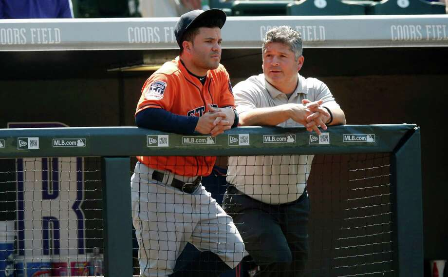 Second baseman Jose Altuve, left, doesn't like the view from the bench, but he's abiding by the wishes of trainer Nate Lucero, right, and manager A.J. Hinch. Photo: David Zalubowski, STF / AP