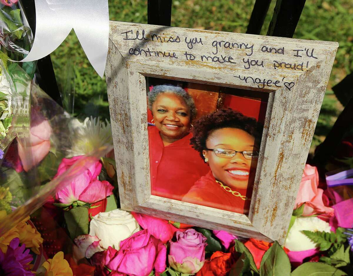 """A framed photograph bearing the note """"I'll miss you granny and I'll continue to make you proud!"""" is left at the sidewalk memorial at the Emanuel AME Church on Saturday in Charleston, S.C."""