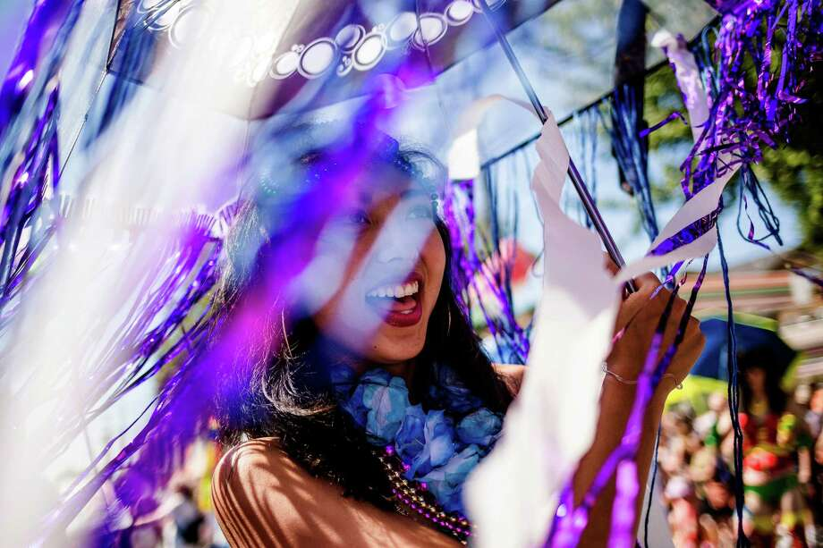 Colorful characters, decked out in costumes and smiles, take to the streets. Photo: JORDAN STEAD, SEATTLEPI.COM / SEATTLEPI.COM