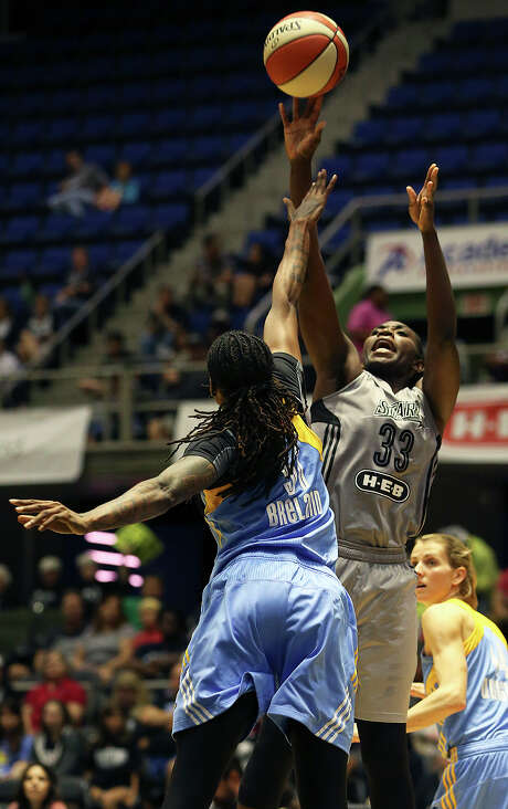 Sophia Young-Malcolm gets off a jumper against Jessica Breland as the San Antonio Stars host the Chicago Sky at Freeman Coliseum on June 20, 2015. Photo: Tom Reel / San Antonio Express-News
