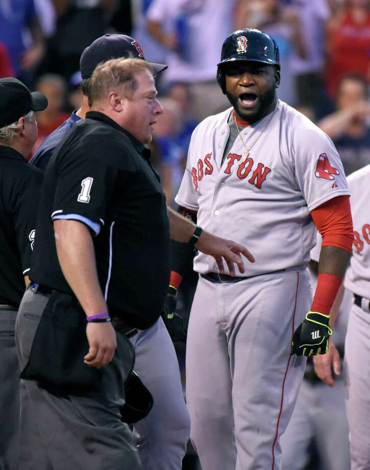 KANSAS CITY, MO - JUNE 20: David Ortiz #34 of the Boston Red Sox argues with plate umpire Bruce Breckman after he was ejected from the game in the seventh inning against the Kansas City Royals at Kauffman Stadium on June 20, 2015 in Kansas City, Missouri. (Photo by Ed Zurga/Getty Images) ORG XMIT: 538583077 Photo: Ed Zurga / 2015 Getty Images