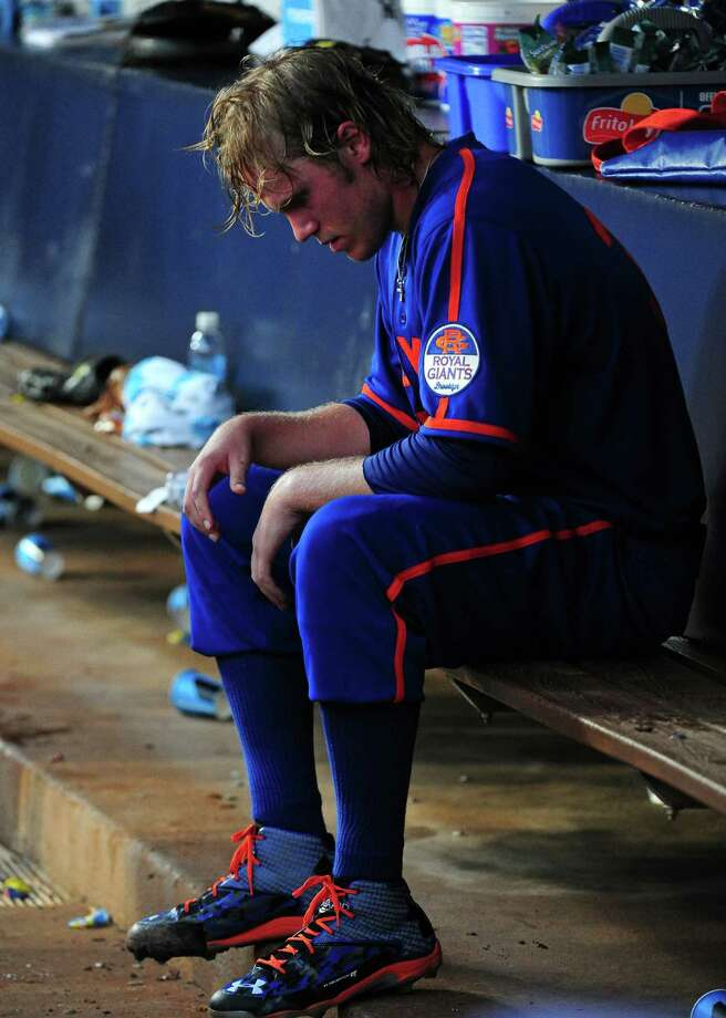 ATLANTA, GA - JUNE 20: Noah Syndergaard #34 of the New York Mets sits in the dugout after being removed from the game after the fourth inning against the Atlanta Braves at Turner Field on June 20, 2015 in Atlanta, Georgia. (Photo by Scott Cunningham/Getty Images) ORG XMIT: 538583167 Photo: Scott Cunningham / 2015 Getty Images
