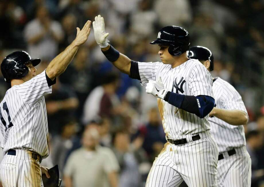 New York Yankees' Alex Rodriguez (13) celebrates with Brett Gardner (11) after Rodriguez hit a three run home run during the third inning of a baseball game against the Detroit Tigers Saturday, June 20, 2015, at Yankee Stadium in New York. (AP Photo/Frank Franklin II) ORG XMIT: NYY131 Photo: Frank Franklin II / AP