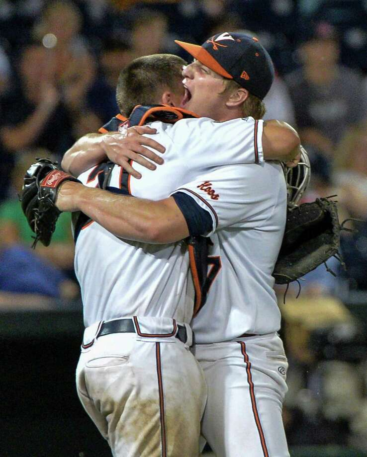 Virginia closing pitcher Josh Sborz, right, celebrates with catcher Matt Thaiss following an NCAA College World Series baseball elimination game against Florida in Omaha, Neb., Saturday, June 20, 2015. Virginia won 5-4 and advances to play Vanderbilt in the championship series. (AP Photo/Ted Kirk) ORG XMIT: NENH117 Photo: Ted Kirk / FR34398 AP