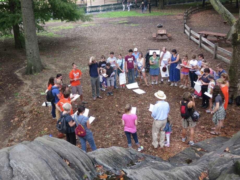 Young evangelicals hold a prayer circle as many persons of faith are coming to a belief that climate change is placing a burden onto the world's poor. Photo: Kaleb Nyquist /Young Evangelicals For Climate Action / KALEB NYQUIST/YOUNG EVANGELICALS