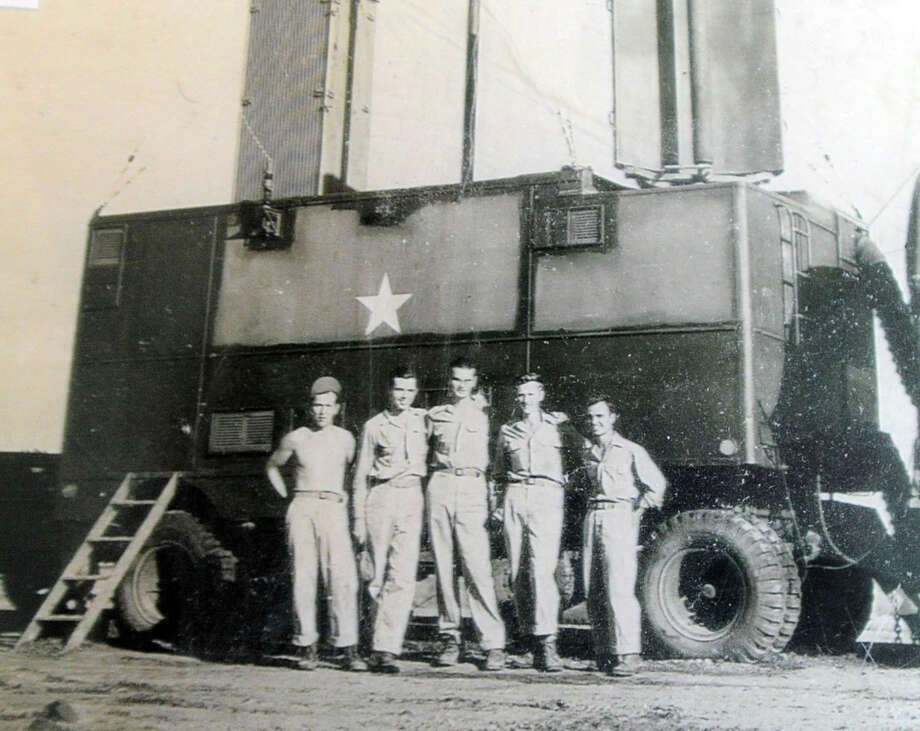 At right, George Chelwick with his U.S. Air Force unit at Nichols Field in the Philippines in 1945 during WW II. Photo: Bob Luckey / Hearst Connecticut Media / Greenwich Time