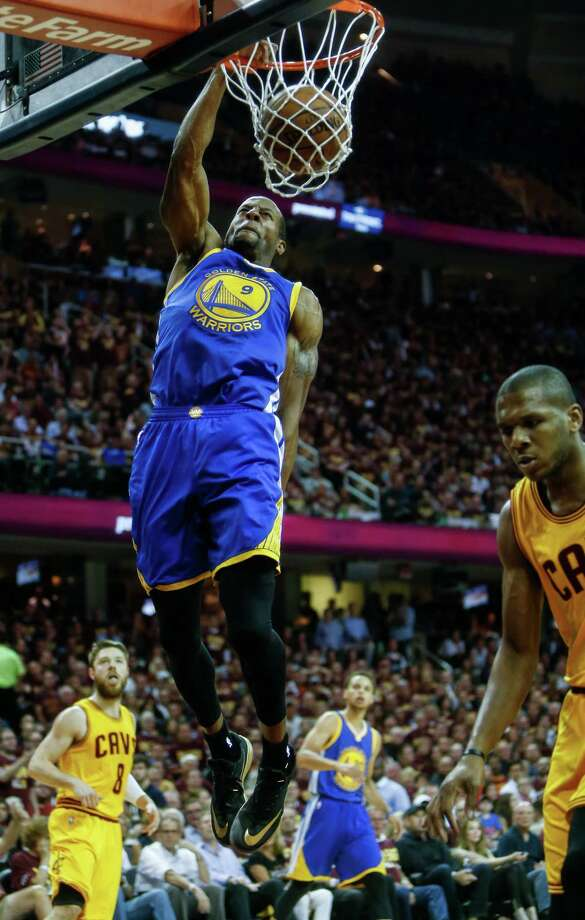 Golden State Warriors' Andre Iguodala dunks the ball in the first period during Game 4 of The NBA Finals between the Golden State Warriors and Cleveland Cavaliers at The Quicken Loans Arena on Thursday, June 11, 2015 in Cleveland, Ohio. Photo: Scott Strazzante / The Chronicle / ONLINE_YES