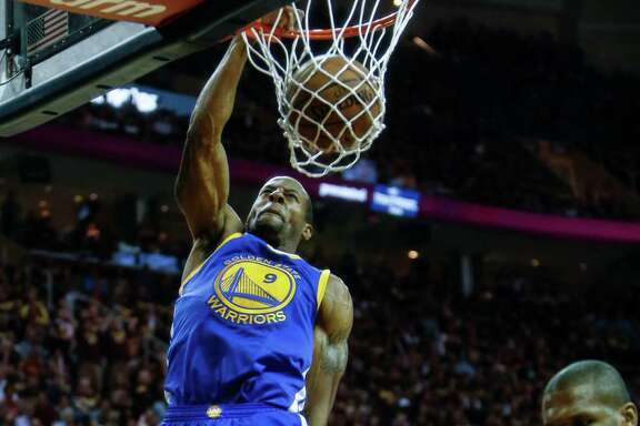 Golden State Warriors' Andre Iguodala dunks the ball in the first period during Game 4 of The NBA Finals between the Golden State Warriors and Cleveland Cavaliers at The Quicken Loans Arena on Thursday, June 11, 2015 in Cleveland, Ohio.