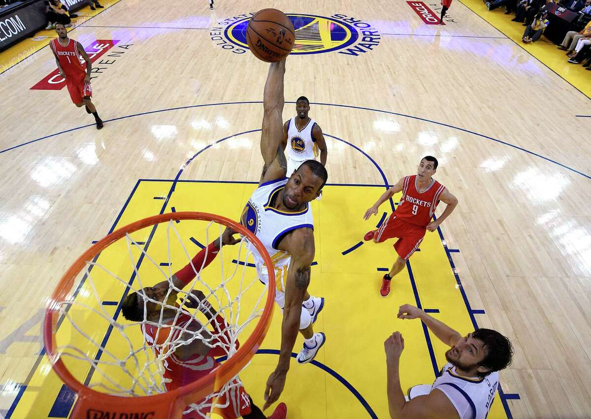 OAKLAND, CA - MAY 21: Andre Iguodala #9 of the Golden State Warriors goes up for a dunk in the second quarter against Dwight Howard #12 of the Houston Rockets during game two of the Western Conference Finals of the 2015 NBA PLayoffs at ORACLE Arena on May 21, 2015 in Oakland, California. NOTE TO USER: User expressly acknowledges and agrees that, by downloading and or using this photograph, user is consenting to the terms and conditions of Getty Images License Agreement. (Photo by Pool - John Mabanglo/Getty Images)