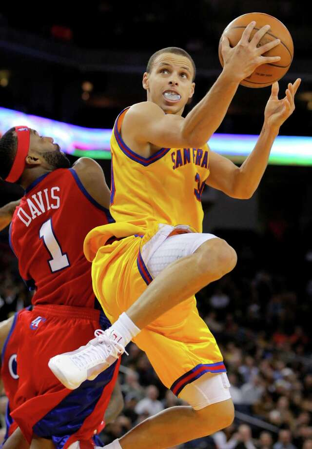 By February of his first season, Curry was en route to the first triple-double by a Warriors rookie since Chris Webber in 1993 when he put up a shot past Baron Davis of the Clippers. But Curry's bad-ankles phase was still in the future. Photo: Carlos Avila Gonzalez / Carlos Avila Gonzalez / The Chronicle 2010 / SFC
