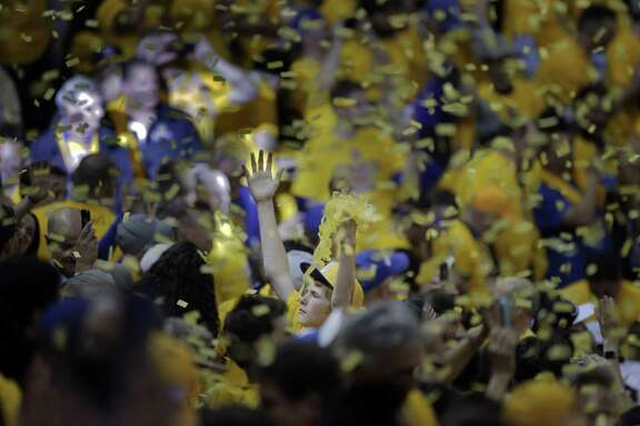 A Warriors fan celebrates the team's 108-100 overtime win over the Cavaliers at the end of Game 1 of the NBA Finals between the Golden State Warriors and the Cleveland Cavaliers at Oracle Arena in Oakland, Calif., on Thursday, June 4, 2015.