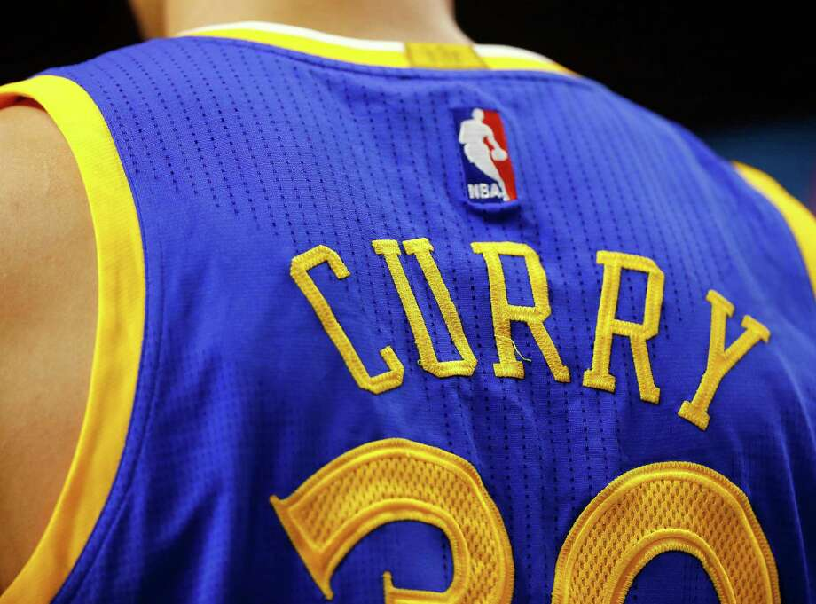 Golden State Warriors' Stephen Curry jersey is seen during the second half of the Golden State Warriors 106-101 win over the Boston Celtics in an NBA basketball game in Boston Sunday, March 1, 2015. (AP Photo/Winslow Townson) Photo: Winslow Townson / AP / FR170221 AP