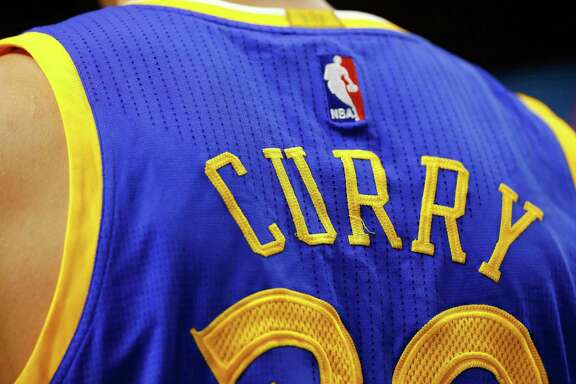Golden State Warriors' Stephen Curry jersey is seen during the second half of the Golden State Warriors 106-101 win over the Boston Celtics in an NBA basketball game in Boston Sunday, March 1, 2015. (AP Photo/Winslow Townson)