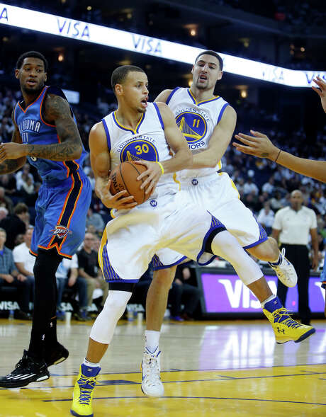 Golden State Warriors' Stephen Curry and Klay Thompson during 117-91 win over the Oklahoma City Thunder in NBA game at Oracle Arena in Oakland, Calif. on Monday, January 5, 2015. Photo: Scott Strazzante / The Chronicle / ONLINE_YES