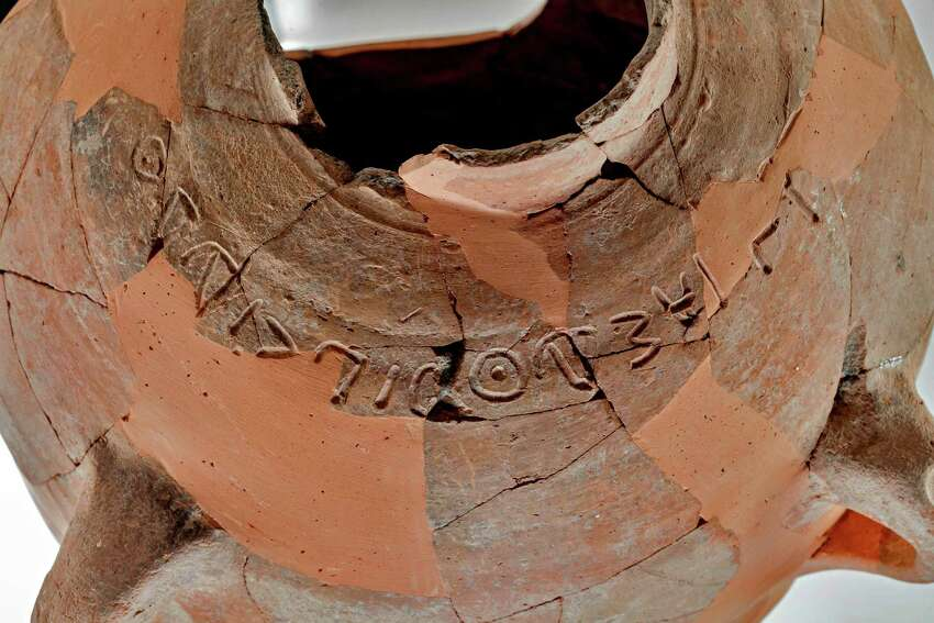 This undated photo released by the Israel Antiquities Authority, shows a 3.000 year old ceramic jar with inscription of a name mentioned in the Bible,