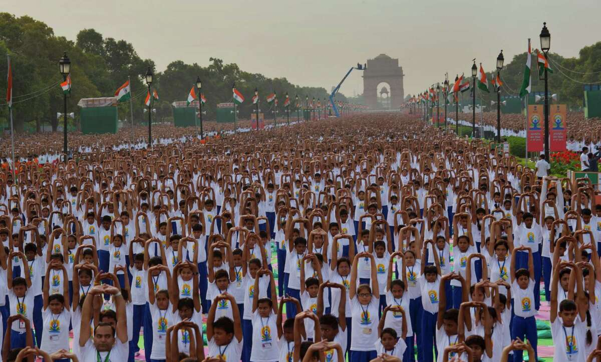 Indians perform yoga on Rajpath, in New Delhi, India, Sunday, June 21, 2015. Millions of yoga enthusiasts are bending their bodies in complex postures across India as they take part in a mass yoga program to mark the first International Yoga Day.