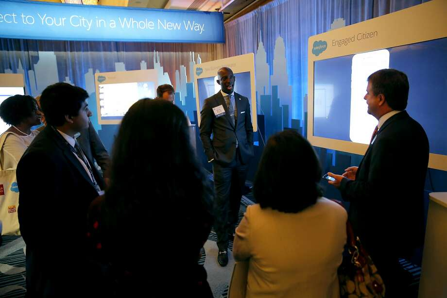 Miramar, Florida, Mayor Wayne Messam (center) and other mayors or their representatives discuss Salesforce products with a spokesperson from the company during the U.S. Conference of Mayors in San Francisco, California, on Saturday, June 20, 2015. Photo: Connor Radnovich, The Chronicle